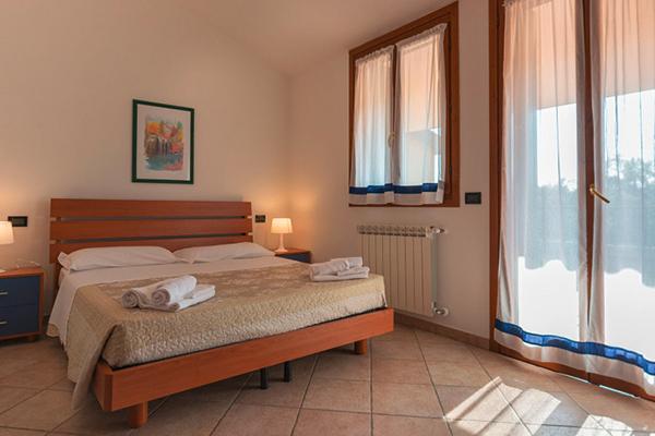 Italien Venetien Albarella Residences Fiordo Diamante Schlafzimmer
